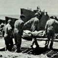 Evacuating wounded from Gela , Sicily.